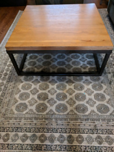 Solid wood coffee table with iron legs