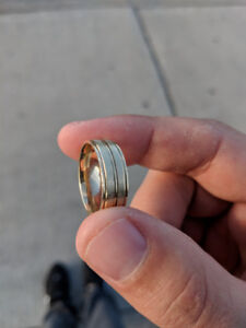 14 k gold men's wedding band, two years old, in good condition.