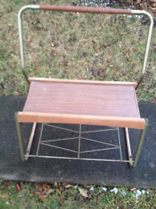 Vintage metal TV stand with wire shelf