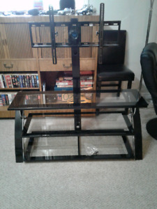 Flat screen tv stand with shelves.
