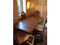 Extending table and chairs