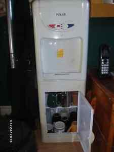 For sale: hot/cold water dispenser with storage cupboard shelves