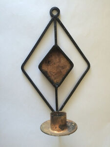 Pretty black and gold wall candle holder for sale!