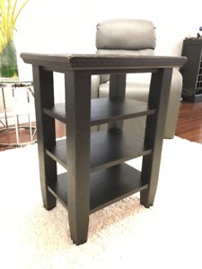 End table with shelves, solid wood distressed look, black.