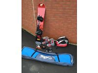 Snowboard, boots, bindings and travel bags with extras
