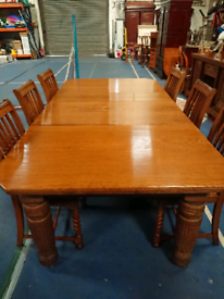 Oak extending table and 6 chairs