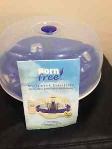 Brand New Born Free Microwave Sterilizer & 4 New bottles $30