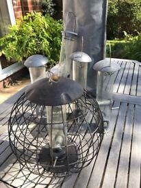 5 Bird feeders, one squirrel proof