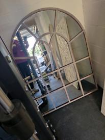 Metal framed window mirror