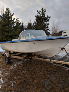 1970's 14ft fibreglass boat with two engines.