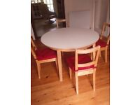 Extending dining table + Four Chairs