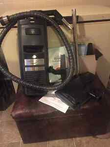 ELECTROLUX  CLASSIC( PLUS CASE AND ALL ATTACHMENTS)