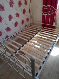 Cream metal bed