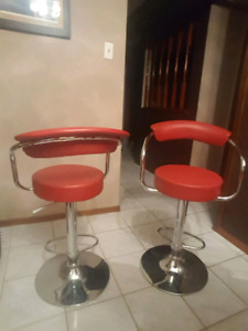 2 red leather swivel stools