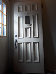 """Exterior door 2"""" thick solid wood, all hardware attached $120.00"""