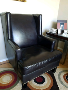 Two leather chairs and coffee table