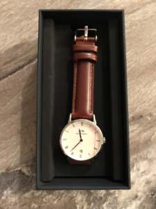 Montre Daniel Wellington + bracelet de montre 150$