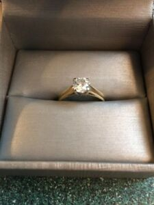 14 kt, .75 carat round diamond solitaire engagement ring.