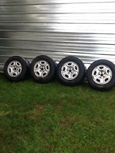 """Toyota 15"""" studded winter tires, rims and nuts"""