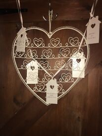 Hanging heart and houses.