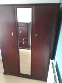 Three piece bedroom furniture in mahogany