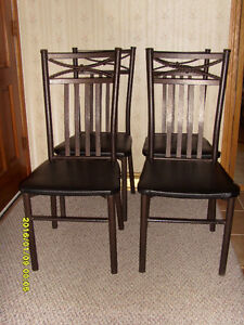 Table and Four Chairs - $280