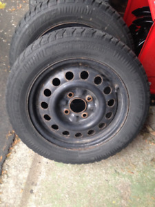 15 inch four bolt snow tires & rims. NEW PRICE!
