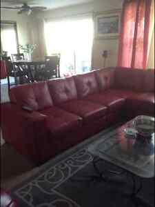 Red leather sectional sofa w/ coffee table