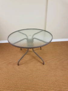 Outdoor glass patio table