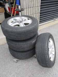 A set of Aluminum Alloy Rims for sale with tire