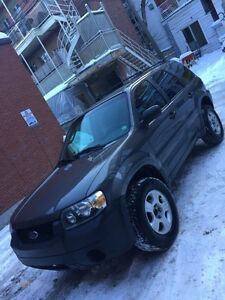 ford escape 2005 really good on gas greate condition;)