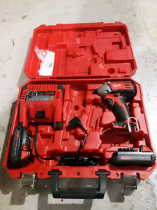 Brand new Milwaukee impact driver, two batteries and a charger