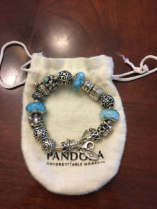 PANDORA BRACELET FILLED WITH CHARMS