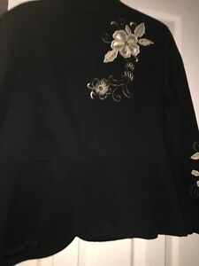 Black decorative jackets. Beautiful embroidery design .
