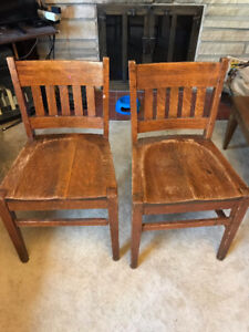 Pair of antique solid oak chairs