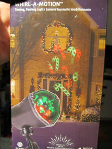 BNIB LED light show projector candy cane design.