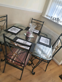Wrought iron and glass table and chairs