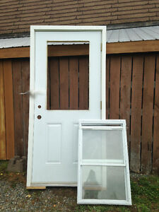 "Brand New 36"" Steel Door with Slider Window"