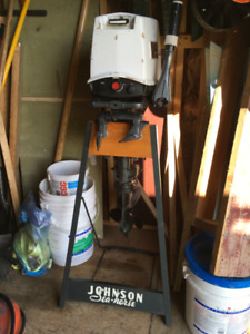 1968 Johnson  20 hp Outboard with Showroom stand.
