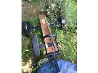 Chunky motorcycle trailer with spare wheel hanger