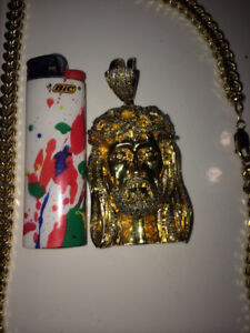 14k large chain and Jesus piece