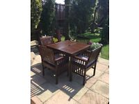 LOVELY SOLID WOOD FSC GARDEN DINNING TABLE AND 4 CHUNKY ARM. HAIRS WITH CUSHIONS