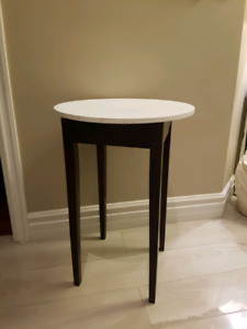 Tall round side table.