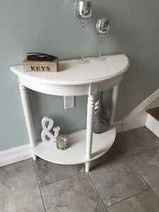 Crescent shaped white console table