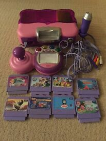 Vtech Smile console with 8 games