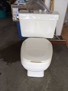 Toilet white. Porcelain, water saver, new condition.