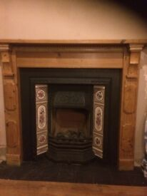 Fire surround cast iron back and gas fire.