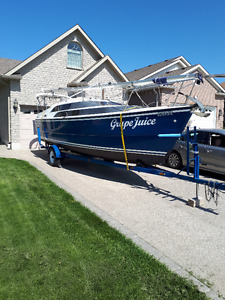 Macgregor 26M blue hull with Honda 50 HP outboard