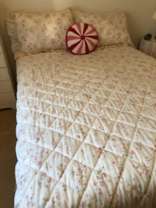 Double bed with mattress and frame.