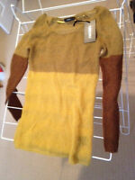 Mustard yellow knit sweater with brown accents